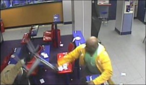 Take That! An armed robber is struck by a chair wielding customer